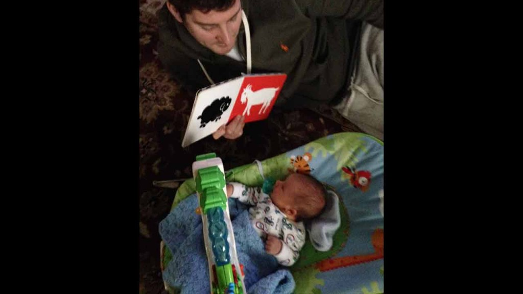 It's important to start reading young. Start with baby books that show pictures with contrasting colors.