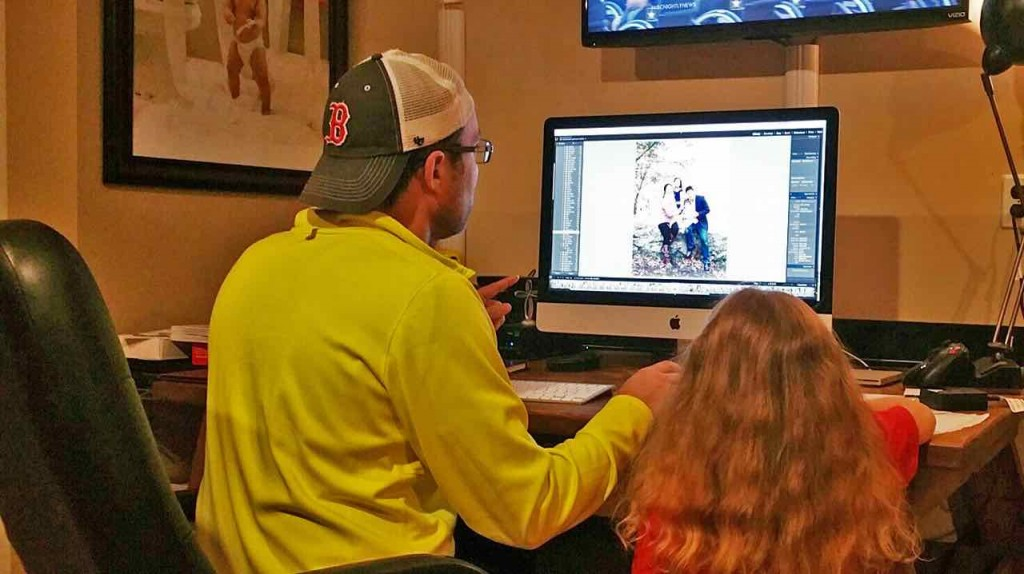 Dan's daughter helps him add some final tweaks to our family photo!