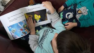 """We printed one of my son's ebooks at Staples. This is him reading his """"published"""" book to his younger brother."""
